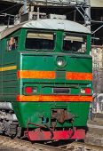 pic of locomotive  - Industrial green cargo train diesel locomotive cabin with red warning stripes - JPG