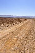 stock photo of dirt road  - Dirt Road of the Negev Desert in the Evening - JPG
