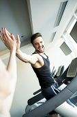 picture of treadmill  - Young man training on a treadmill in the gym - JPG