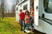foto of camper  - Family vacation, RV (camper) travel with kids, happy parents with children on holiday trip in motorhome
