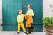 stock photo of casual wear  - Outdoor portrait of adorable fashion kids - JPG