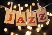 foto of jive  - The word JAZZ printed on clothespin clipped cards in front of defocused glowing lights - JPG
