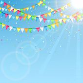 image of confetti  - Holiday pennants and confetti on sky background - JPG
