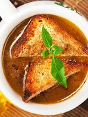 foto of onion  - Famous onion soup with onions and olive oil in the background close up - JPG