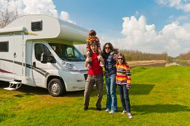 image of recreational vehicle  - Family vacation, RV (camper) travel with kids, happy parents with children on holiday trip in motorhome