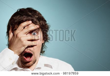 Closeup Portrait Of Handsome Young Man Looking Shocked, Surprised In Disbelief, With Hands On Face L