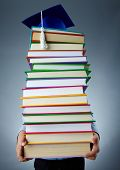 stock photo of graduation cap  - Image of stack of books held by child - JPG
