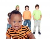 Funny afroamerican baby with other children unfocused of background poster