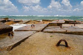 stock photo of breaker  - The Mediterranean Sea shore with sea wave rock breaker in Alexandria Egypt - JPG