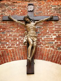 pic of crucifixion  - Crucifixion of Christ in the old red brick masonry - JPG