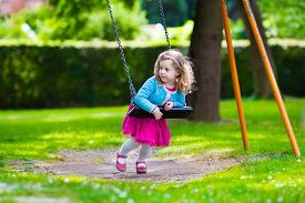 stock photo of playground school  - Little girl on a playground - JPG