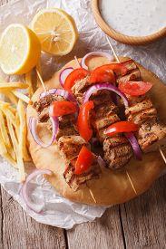 foto of souvlaki  - Greek souvlaki with pita bread and vegetables close - JPG