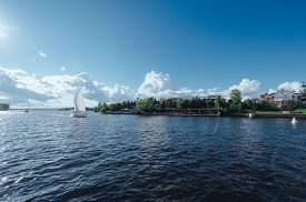 stock photo of sails  - View from the board of a sailing yacht on the waters - JPG