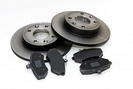 image of four-wheel  - four brake pads and two new brake discs for the car - JPG