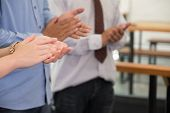 Young Businessman Applauding To Speaker After Seminar Presentation. Business Partners Clapping Hands poster