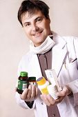 Doctor With Variety Of Medicines poster