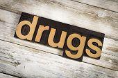 Drugs Letterpress Word On Wooden Background poster