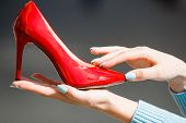 Footwear Or Shoe Red Color Leather On Female Hand poster