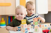 Kids Boys Playing With Toy Blocks At Home Or Kindergarten poster