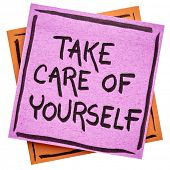 Take care of yourself reminder handwriting on an isolated sticky note poster