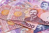 stock photo of nzd  - Detail of Dollar notes in New Zealand currency - JPG