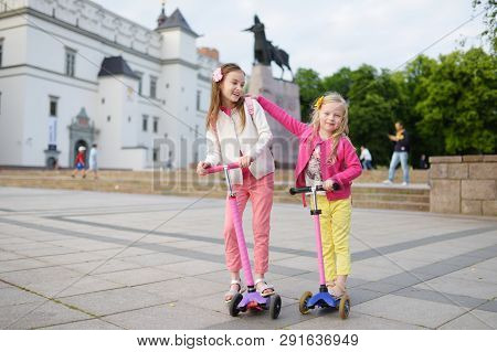 Small Children Learning To Ride