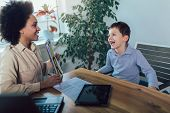 Shot Of A Speech Therapist During A Session With A Little Boy poster