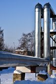 Overground Heat Pipes. Pipeline Above Ground, Conducting Heat For Heating The City. Winter. Snow. poster