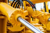 Powerful Hydraulic Cylinders. The Main Power And Driving Element For Construction Equipment. poster