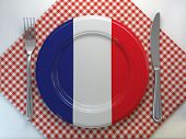 French cuisine  or french restaurant concept. Plate with flag of France with knife and fork. 3d illu poster