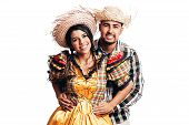 Brazilian Couple Wearing Traditional Clothes For Festa Junina - June Festival - Dancing Isolated On poster