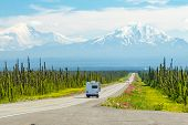 Recreational Vehicle (rv) Headed To The Alaska Range Mountains On Horizon At The End Of Long Highway poster