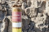Post On The Fuerteventura Mountains Informing Hikers About The Trail. poster