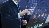 Businessman Entering Passcode On Modern Virtual Touch Screen As An Access To Investment Risk Managem poster