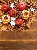 foto of christmas spices  - Christmas background made of nuts fruits and spices - JPG