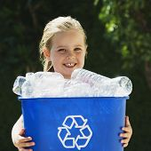 stock photo of recycling bin  - Little blond Girl Holding blue Recycling Bin - JPG
