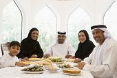 Middle Eastern Family Sat Around Table Eating Food