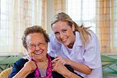 foto of geriatric  - a home care nurse visits a patient - JPG