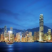 stock photo of hsbc  - Victoria Harbour at Hong Kong at night - JPG