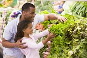 pic of grocery-shopping  - Father and daughter shopping for lettuce at a grocery store - JPG