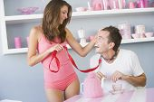 stock photo of slave-house  - Young woman joking around with boyfriend on a leash - JPG