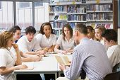 stock photo of hair integrations  - Students and teacher in a study group collaborating - JPG