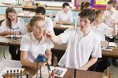 image of tweeny  - Students performing science experiments in classroom - JPG