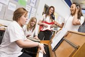 Teen Pupils In Music Lesson