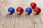 image of shaky  - Small New Year decoration balls on old wooden background - JPG