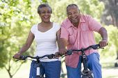 picture of elderly couple  - Senior couple on bicycles - JPG