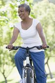 stock photo of elderly woman  - Senior woman on a bicycle - JPG