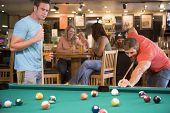 pic of hair integrations  - Two men playing pool - JPG