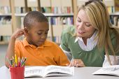 pic of reading book  - Student in class reading with teacher - JPG