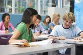 stock photo of students classroom  - Students studying in geography class - JPG